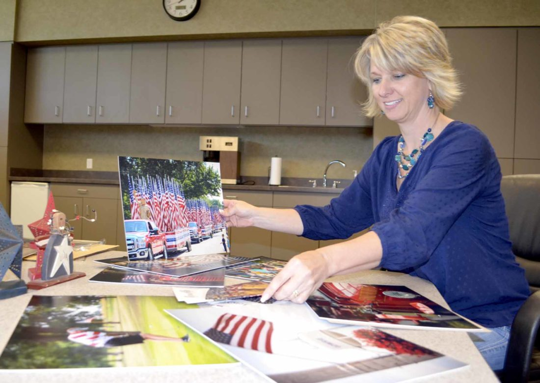 -Messenger photo  by Kriss Nelson  Marcie Boerner, of Gowrie, works on an exhibit that will be featured at the Greater Fort Dodge Growth Alliance.