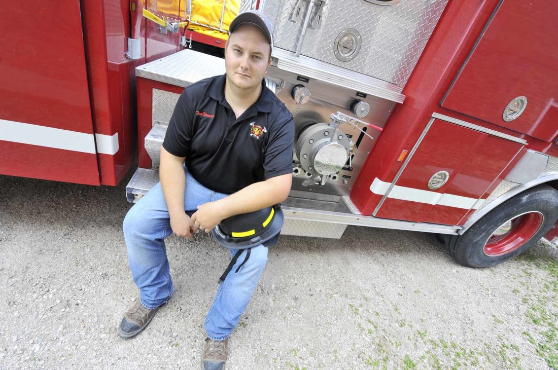 -Messenger photo by Hans Madsen  Dayton volunteer firefighter Dan Stewart poses with one of the department's pumper trucks recently. Stewart is one of the department's newest members. He joined in June of 2016 when her moved to Dayton.