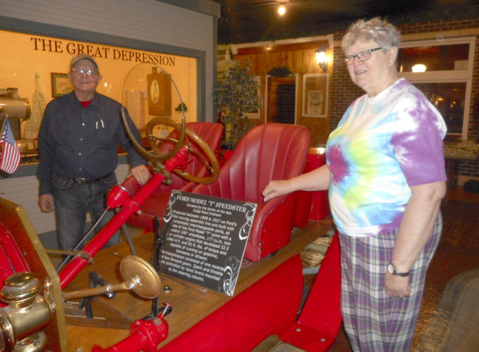 -Messenger photo  by Karen Weld  Mary Tesdahl stands near one of the newest acquisitions for Clarion's Heartland Museum,  Judge Newt Draheim's 1927 roadster.
