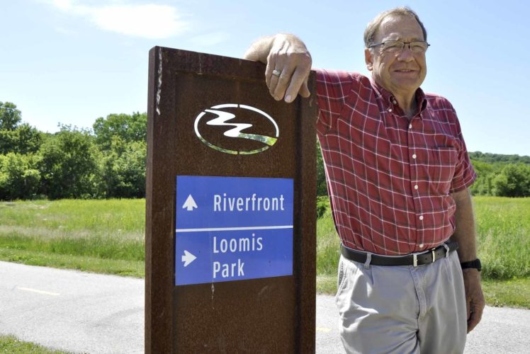 -Messenger photo by Joe Sutter  Bob Singer poses at the trail heading down to the river. As Fort Dodge Chamber of Commerce director for many years Singer saw the need for increased recreational opportunities in Fort Dodge. Singer said in the future he expects the riverfront to be developed.