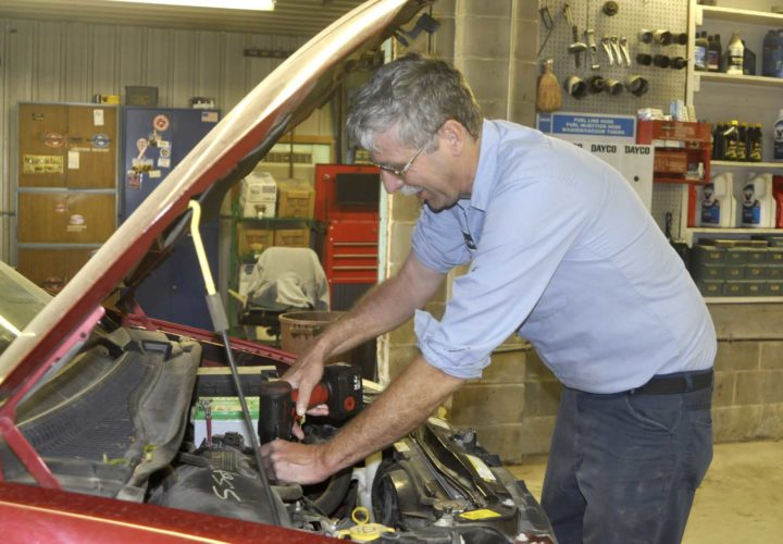 -Messenger photo by Peter Kaspari  Clarence Siepker, of Laurens, fixes up a car in his shop recently. A longtime Laurens business owner, Siepker has also held a number of leadership roles in the community, including serving as fire chief and a current Pocahontas County Supervisor.