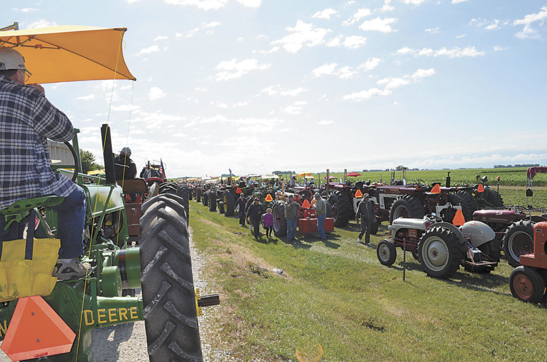 -Messenger photo  by Kriss Nelson  The 21st annual WHO Radio Tractor Ride began Monday with a tour from Jefferson with an early stop in Farnhamville and lunch in Dayton. This year, 450 registered tractors are participating in the three-day event.