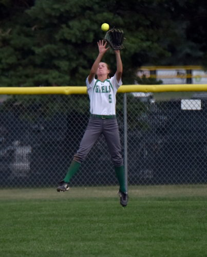 -Messenger photo by Britt Kudla Megan Flattery of St. Edmond catches a fly ball against North Union on Thursday during Senior Night at Rogers Park