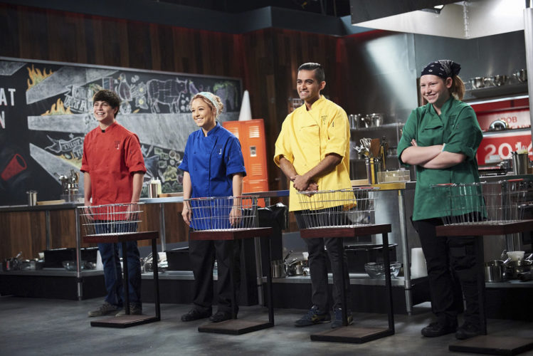 """-Submitted photo by the Food Network   FDSH graduate Colton Austin, left, with fellow contestants Kayla Ast, Omar Saber and Nikiena Sunbury are shown at the start of Round 1 of """"Cutthroat Kitchen,"""" in this photo by the Food Network. Austin's episode airs Wednesday and Thursday, and will feature the students joining a clique to make a breakfast, creating a sack lunch, and trying to prep a snack while standing inside a locker."""