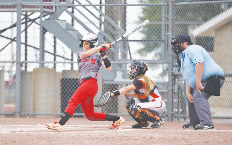 -Messenger photo by Britt Kudla Maggie Harvey of Fort Dodge connects for a hit against Ames on Friday