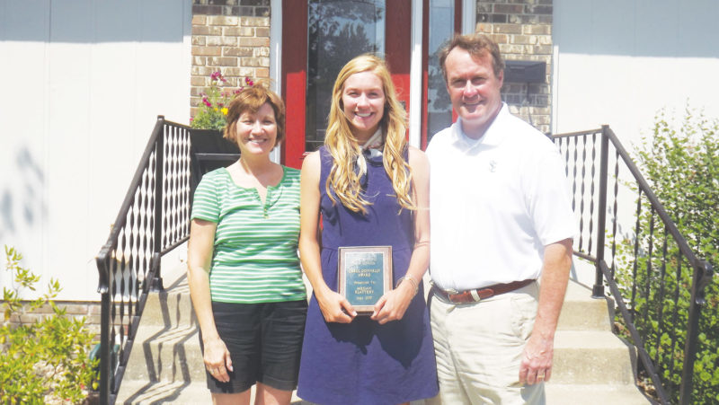 —Messenger photo by Dana Becker  st. edmond senior megan flattery stands with her parents, Debbie and Dave Flattery. Flattery was named the 2017 Carol DonnellyAward winner, given annually to the top female athlete at St. Edmond.