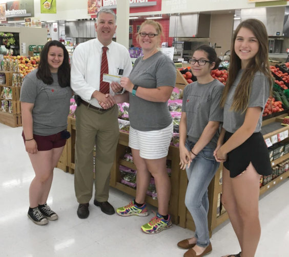 "Tim Flaherty, store director for Hy-Vee in Fort Dodge, organized a ""round-up week"" at Hy-Vee to raise funds for the Kosovo Youth Exchange. Four students from Fort Dodge Senior High will go to TOKA, an International Student camp in Kosovo. A total of $343.07 was raised from the round-up and another $1,348 was raised through additional donations and T-shirts sales.  Pictured from left are Makayla Pingel, Flaherty, Jolene Hays, Jeannie Boro and Jordyn Kloss."
