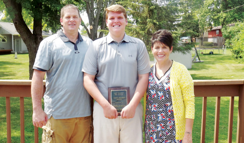 Messenger photo by Dana Becker  st. edmond senior charlie doyle stands with his parents, Tim and SusanDoyle. Doyle was named the 2017 Terry GriffeyAward winner, given annually to the top male athlete at St. Edmond.