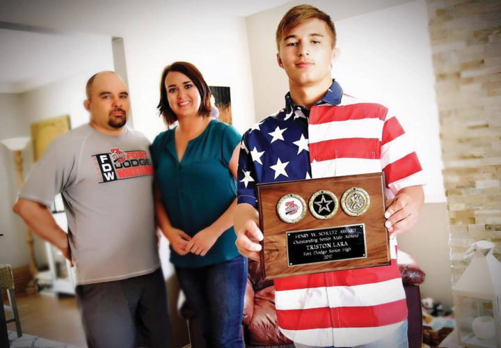 Messenger photo by Britt Kudla  Triston Lara poses with his Henry W. Schultz Award as his parents, Nick and Jamie, look on. Lara was honored as Fort Dodge Senior High's top male senior athlete from the 2017 class.