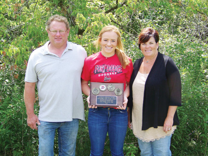 Messenger photo by Eric Pratt  Maggie Harvey poses with her Florence Nordman Award next to her parents, Joe and Kelly. Harvey was honored as Fort Dodge's top female senior athlete from the 2017 class.