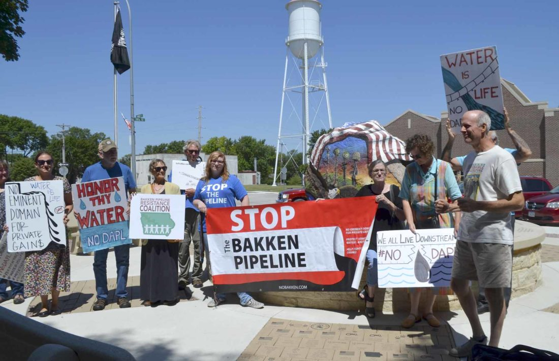 -Messenger photo by Joe Sutter Ed Fallon, at right, speaks at a press conference with pipeline protesters during a break in the trial of protester Heather Pearson, in front of the Freedom Rock at the Calhoun County Courthouse.