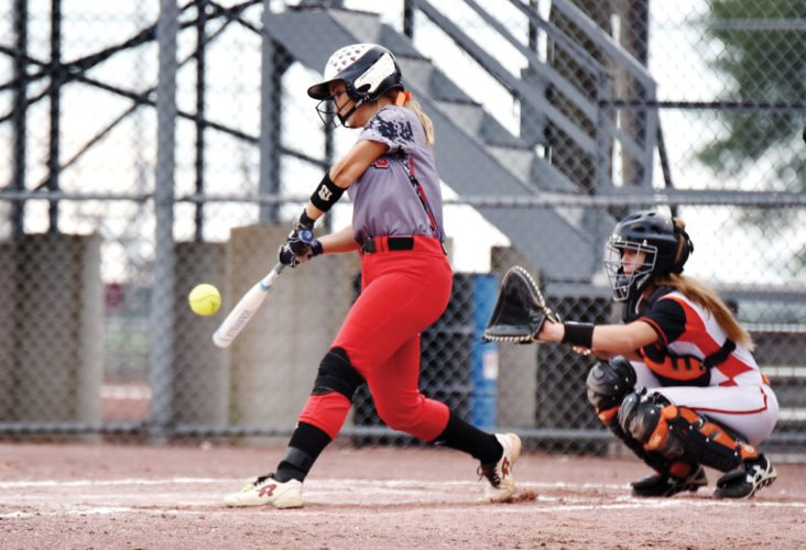 Messenger photo by Britt Kudla  Bre Tjebben of Fort Dodge hits an RBI double against Ames last week at Rogers Park.