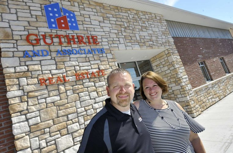 -Messenger photo by Hans Madsen  Katie and Scott Underberg, co-owners of Guthrie and Associates Real Estate, pose in front of their newly renovated offices at 1302 Central Avenue in Fort Dodge. They also recently moved to this location.