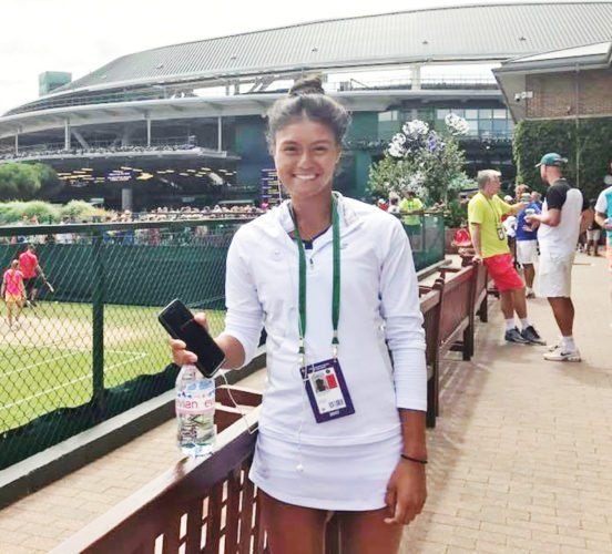 Submitted photo  Fort Dodge's Vicky Flores stands outside of the All England Tennis Club at Wimbledon in London after advancing out of the qualifying bracket in the junior competition.
