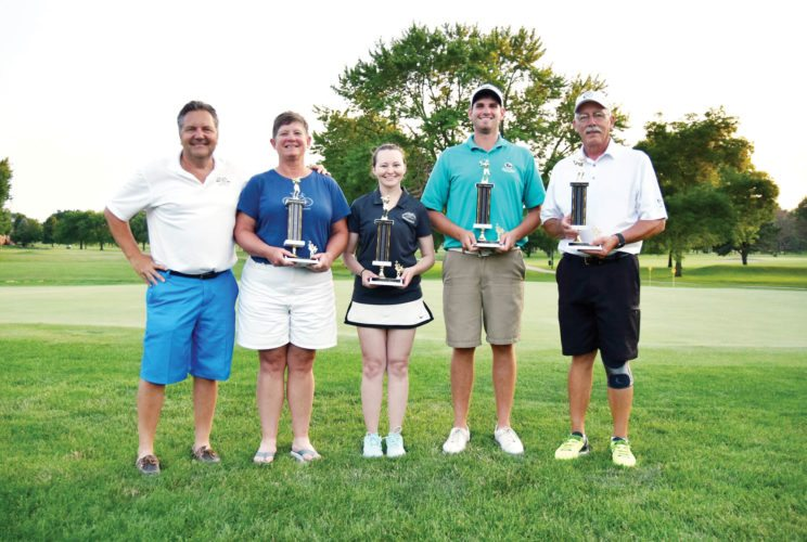 —Messenger photo by Britt Kudla  Fort Dodge Ford Lincoln Toyota owner Casey Johnson (far left) stands with city tournament champions Peg Christensen (women's senior), Kasey Faiferlick (women's open), Eddie Doyle (men's open) and Terry Miller (men's senior) at the Fort Dodge Country Club Sunday night. For more photos, please visit CU.messengernews.net
