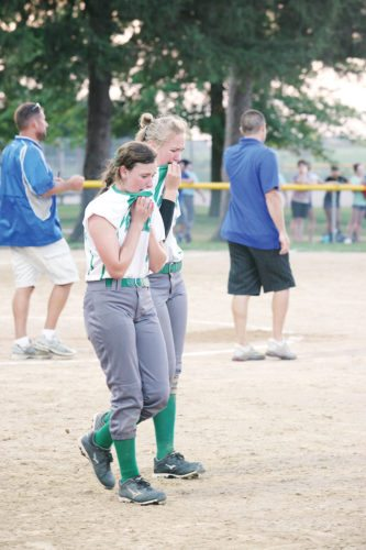 Photo by J.O. Parker, for The Messenger  Gael teammates Jacque Oberg (left)and Jocy Timmerman walk off the field together after Monday's regional final at Montezuma.