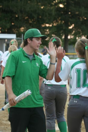 Photo by J.O. Parker, for The Messenger  Nick Clark greets his St. Edmond softball players on Monday in Montezuma.