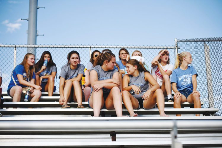 Messenger photo by Britt Kudla  The Humboldt softball team watches Fort Dodge's 5A regional final against Valley in West Des Moines on Tuesday night.