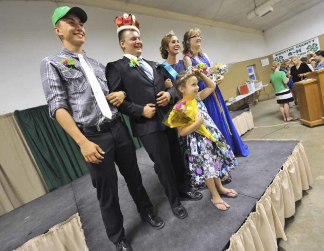 -Messenger photo by Hans Madsen  Freshly crowned Webster County Fair Royalty takes to the stage Wednesday evening after being coronated. They are, left and right, runners up Daven Rees and Karrigan Mentzer along with the 2017 King and Queen, center, Joel Anderson and Brooklyn Border. The 2017 Little Miss Webster County, Leah Fisher, 7, gets a spot in the middle.