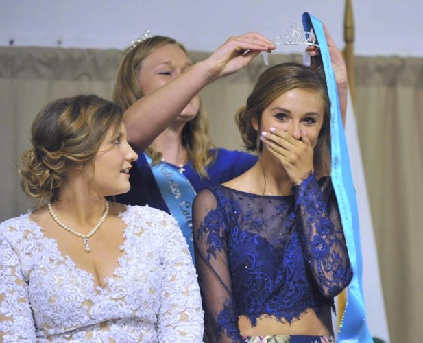 -Messenger photo by Hans Madsen  Brooklin Border is crowned as the 2017 Webster County Fair Queen by 2016 Webster County Fair Queen Anna Heatherington Wednesday night. While Brooklin Border's sister Morgan is also an accomplished 4-Her, she was incorrectly identified as the Fair Queen in the July 13 Messenger.