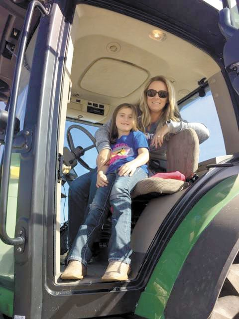 -Submitted  photo  Cristen Clark, shown here with her daughter, Halle, is a voice for agriculture.
