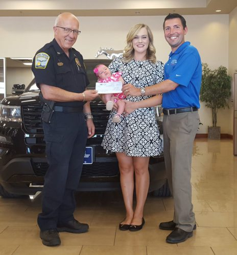 The Fort Dodge Police Department accepts a donation from Fort Dodge Ford Lincoln Toyota to be used to purchase body cameras. Pictured are Fort Dodge Police Chief Emeritus Kevin Doty, Abigail Johnson and Matt Johnson of Fort Dodge Ford Lincoln Toyota, and their daughter, Isabella Johnson.