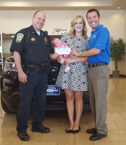 The Fort Dodge Police Department accepts a donation from Fort Dodge Ford Lincoln Toyota to be used to purchase AEDs. Pictured are Fort Dodge Police Lt. Dennis Mernka, Abigail Johnson and Matt Johnson of Fort Dodge Ford Lincoln Toyota, and their daughter, Isabella Johnson.