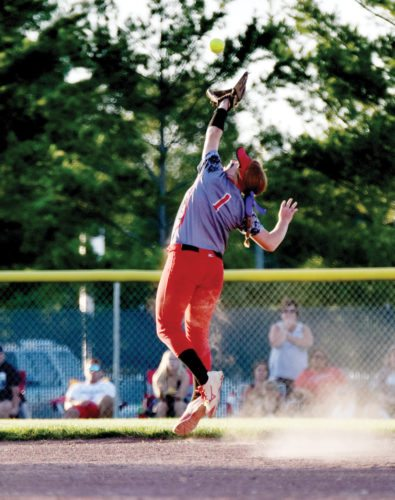 Messenger photo by Britt Kudla  Maggie Harvey of Fort Dodge leaps to make a catch at Rogers Park in a regional semifinal.