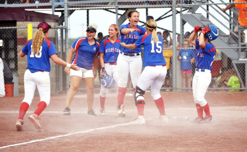 Messenger photo by Britt Kudla  Interstate 35 celebrates after beating Central Springs on Monday at Rogers Park.
