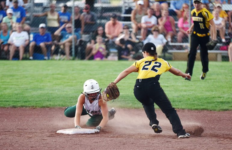 Messenger photo by Britt Kudla  Taylor Hogan of Waterloo Columbus slides against Eddyville-Blakesburg-Fremont on Monday at Rogers Park. For more photos, please visit CU.messengernews.net
