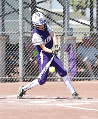 Messenger photo by Britt Kudla  Makayla Walleser of Kee connects for a single against Montezuma on Monday at Rogers Park.