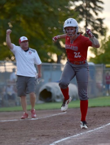 -Messenger photo by Britt Kudla Skylar Rigby of Ballard celebrates after teammate Isabell Hobbs hits a home run against Carlisle during class 4A quarterfinals on Tuesday