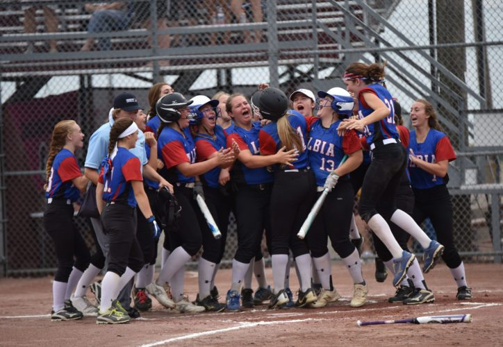 -Messenger photo by Britt Kudla Hannah Isley of Albia celebrate with her teammates after a solo home run against Boyden-Hull Rock Valley during Class 3A quarterfinals on Tuesday