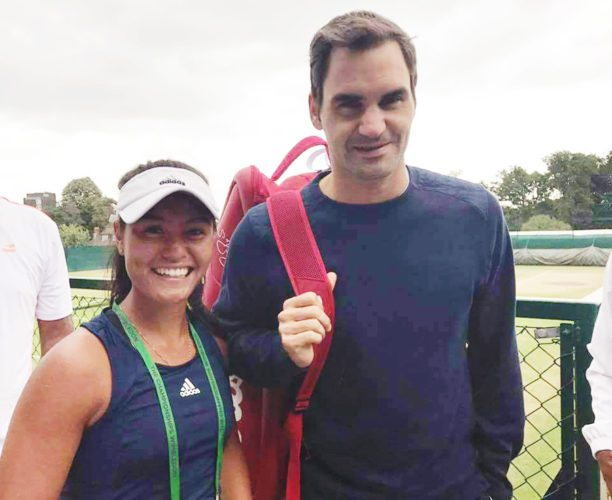 Submitted photo  Vicky Flores of Fort Dodge stands next to tennis icon Roger Federer during her Wimbledon trip in London, England.