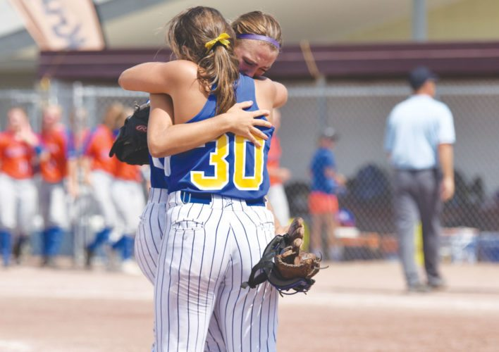 -Messenger photo by Britt Kudla Humboldt Avery Terwilliger and Taylor Gidel (30) celebrates after beating Sioux Center during class 3A consolation finals on Wednesday