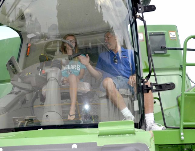 - Messenger photo by Kriss Nelson  Abbie Burger, a Southeast Valley drivers ed student gets some instruction by Webster County Farm Bureau board member John Fredrickson during a farm equipment awareness presentation given to the students.