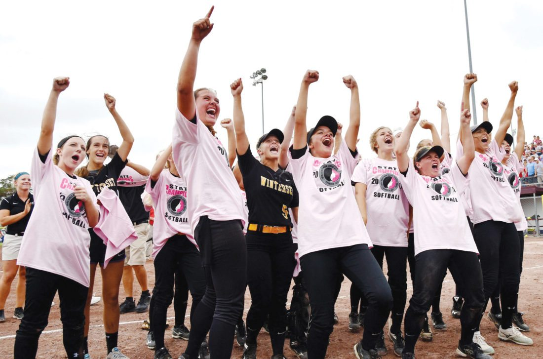 Messenger photo by Britt Kudla  Winterset players celebrate their Class 4A state softball championship on Friday at Rogers Park. For more photos, please visit CU.messengernews.net