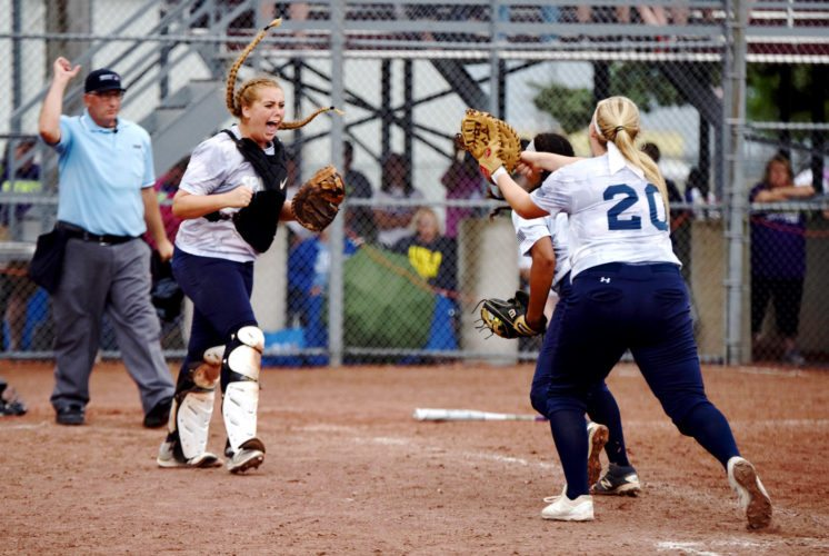 Messenger photo by Britt Kudla  Pleasant Valley teammates Hannah Mausser and Rylee Carlson (20) celebrate their team's Class 5A state title on Friday at Rogers Park. For more photos, please visit CU.messengernews.net