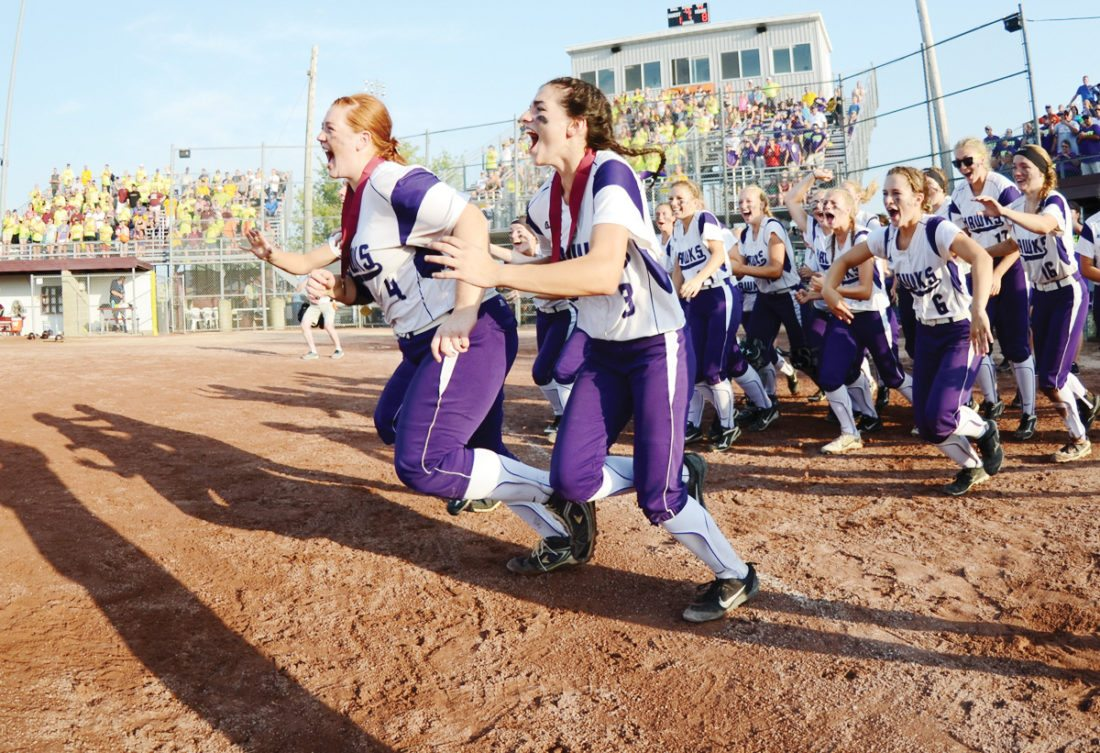 Messenger photo by Britt Kudla  Kee players rush the field to take their 1A state championship trophy on Friday at Rogers Park. For more photos, please visit CU.messengernews.net