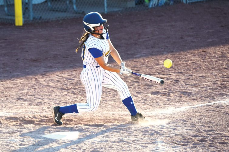 Messenger photo by Britt Kudla  Ellie Jacobson of Humboldt gets a hit at Rogers Park during the regular season.