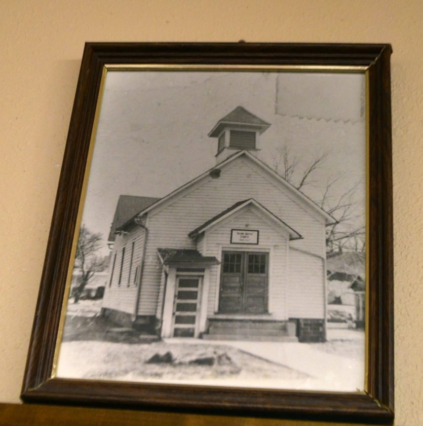 The old Second Baptist Church, built around the turn of the century and moved to this spot in the 1900s, was demolished in the 1970s and a new building built in its place. It's remembered in this photo in the fellowship hall of the new church.