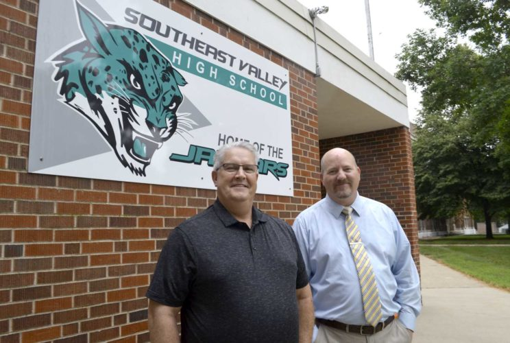 -Messenger photo by Joe Sutter  Two new principals pose outside the Southeast Valley High School. High School Principal Kerry Ketcham, left, and Middle School Principal Greg Slininger were hired this summer and are working to be ready when school starts Aug. 23.