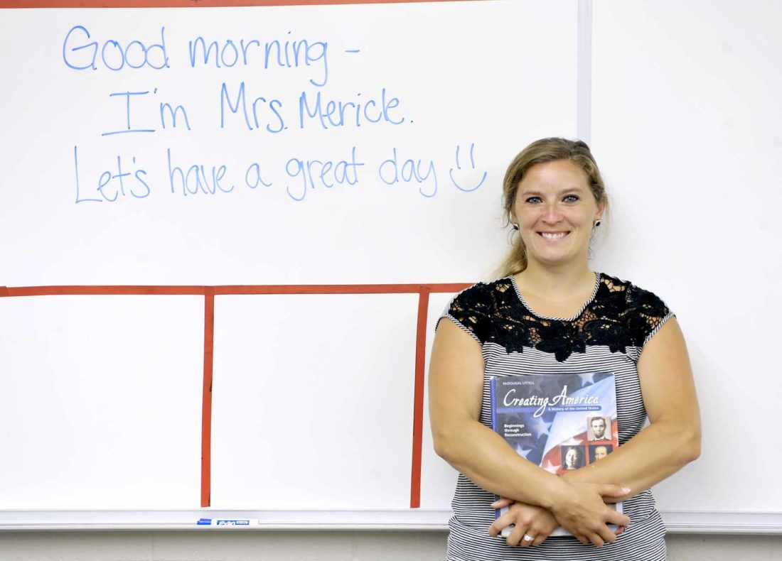 -Messenger photo by Hans Madsen  Fort Dodge Middle School substitute teacher Martha Mericle poses in a classroom at the Fort Dodge Middle School with a typical message she might write for a class when she's filling in.