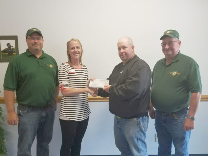 Webster County 4-H received the Landus Cooperative's Core Grant. The donation of $1,000 will be used to support the new 4-H outdoor archery shooting range at the Webster County Fairgrounds. Pictured from left are Troy Harris, 4-H archery instructor; Lindsay Kavanaugh, County Youth coordinator; Blake Beckett, Landus Cooperative; and Dave Anderson, 4-H archery instructor.