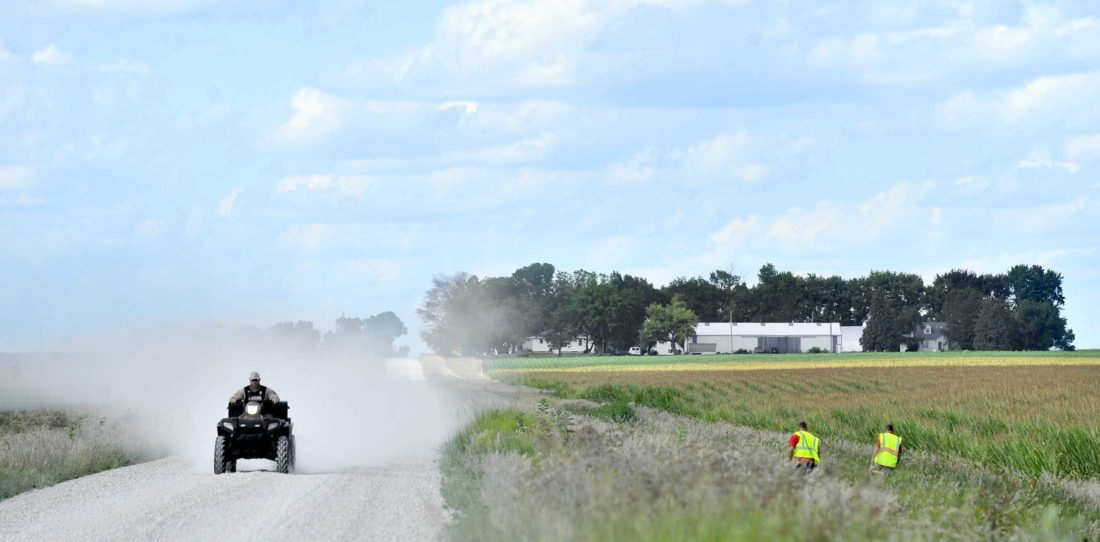 -Messenger photo by Hans Madsen  Clare firefighters Zack Gaul and Danny Licht search a ditch and field edges along Easter Avenue north of 150th Street Friday afternoon as another searcher drives by on an ATV. The multi-agency area search was in relation to the disappearance of Jessica Gomez, 26, of Fort Dodge and Mackenzie Knigge, 26, of Clare. Knigge was located Friday. Gomez, who has not been seen for a week, remains missing.