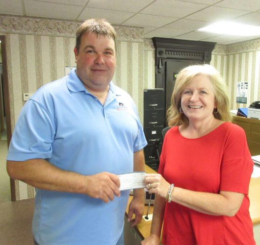 Webster County Farm Bureau accepted donations for area food pantries during the annual Sweetcorn Feed held during the Webster County Fair. Proceeds were divided among The Salvation Army, The Lord's Cupboard and The Gowrie Community Food Pantry. Pictured is Marla Stokesbary, representing the Gowrie Community Food Pantry, accepting a donation presented by WCFB President Steve Peterson.