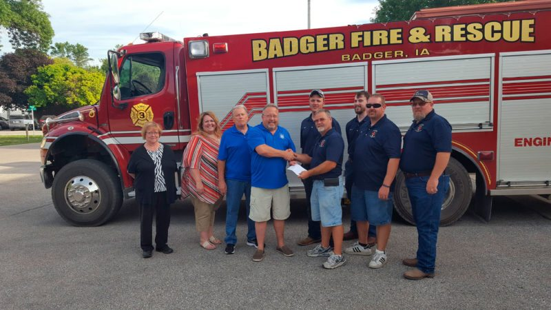 Daybreak Rotary of Fort Dodge recently presented a check for $3,304 to the Badger Fire Department. Pictured from left are Maureen Powers, Letitia Anderson, Mike Craig, Tom Kramer, Matt McClellan, Don Ashenfelter, Jacob Shelton, Chad Swanson, and Dave Condon.