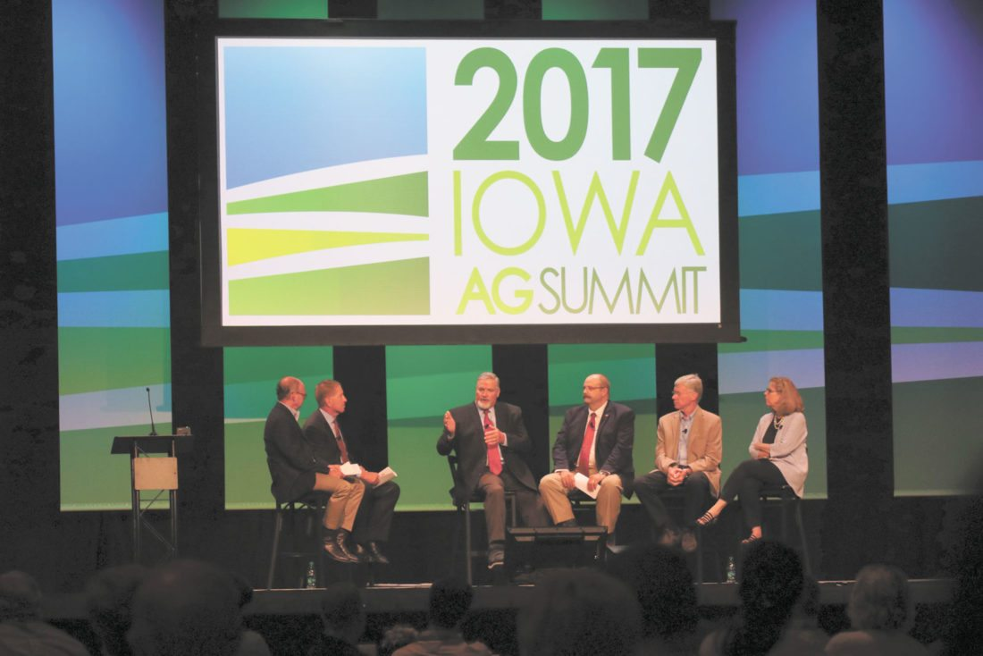 -Messenger photo by Darcy Dougherty Maulsby  A panel discussion on the 2018 Farm Bill covered a wide range of topics, from payment limitations to funding for conservation efforts, during the 2017 Iowa Ag Summit in Des Moines on Aug. 5. Moderator Phil Brasher left, and Iowa Ag Summit host Bruce Rastetter, second from left, visited with panelists including, left to right, Craig Lang, a dairy farmer from Brooklyn, Iowa and former Iowa Farm Bureau Federation president; Craig Uden, a fourth-generation cattleman from Elwood, Nebraska; Gary Wertish, Minnesota Farmers Union president; and Dr. Wendy Wintersteen, endowed dean at the College of Agriculture and Life Sciences at Iowa State University.