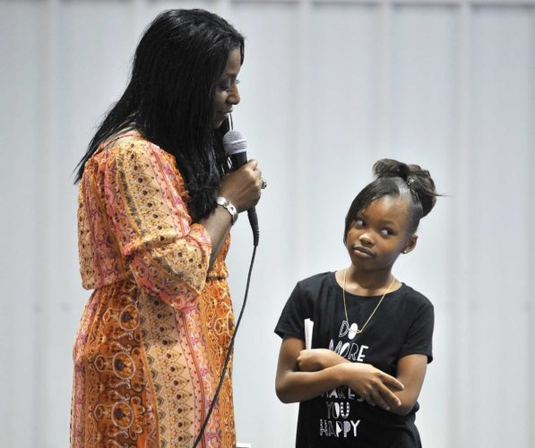 -Messenger photo by Hans Madsen  Diamond Altman, 9, thinks about the question she's about to answer for Shelia Grady-Roberts, at left, during the Miss Diversity Pageant Saturday afternoon at Athletics For Education and Success. Altman read a poem after answering her questions.