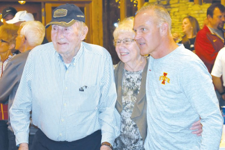 —Messenger photo by Chad Thompson  Kay Kollmorgen, left and Jo Kollmorgen, of Humboldt, pose with Iowa State head wrestling coach Kevin Dresser in Humboldt. Dresser will hold a Town Hall Social at Rustix Restaurant in Humboldt on Saturday.